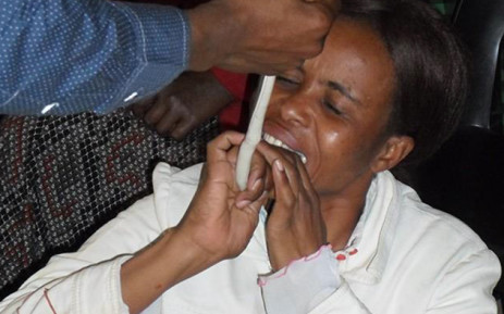 A member of the End of Times Desciples Ministries in Soshanguve eats a snake during a church service. Picture: Supplied/EWN.