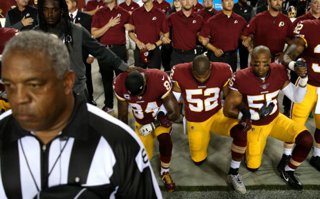 Washington Redskins players kneel during the US national anthem in protest before playing an NFL match against the Oakland Raiders at FedExField on September 24, 2017 in Landover, Maryland. Picture: AFP.