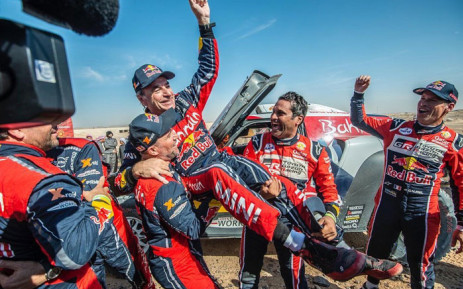 Carlos Sainz is hoisted up by his competitors after winning the 2020 Dakar Rally on 17 January 2020. Picture: @CSainz_oficial/Twitter