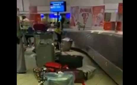 An employee at the OR Tambo International Airport has been suspended after being caught on camera throwing luggage from a baggage carousel.