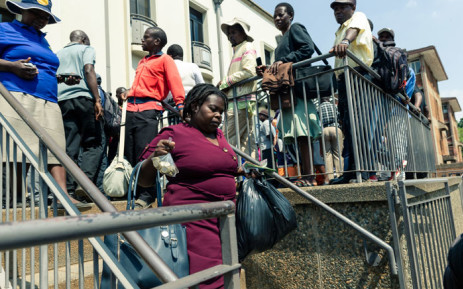 Zimbabweans queue as central bank releases $30mn into market