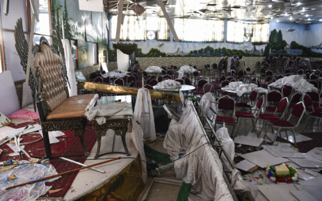 FILE: In this file photo taken on 18 August 2019, Afghan men investigate in a wedding hall after a deadly bomb blast in Kabul. For years, as violence raged through Afghanistan, lavish weddings offered a rare opportunity for celebration, but now even that is under threat after last weekend's deadly attack on a party venue sent shock waves through one of Kabul's key industries. Picture: AFP