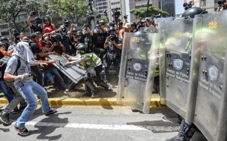 FILE: Venezuela's opposition activists clash with riot police agents during a protest against Nicolas Maduro's government in Caracas on April 4, 2017. Picture:  AFP.