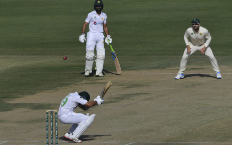 Pakistan's Azhar Ali (bottom C) avoids the ball during the second day of the first cricket Test match between Pakistan and South Africa at the National Stadium in Karachi on 27 January 2021. Picture: Asif Hassan/AFP