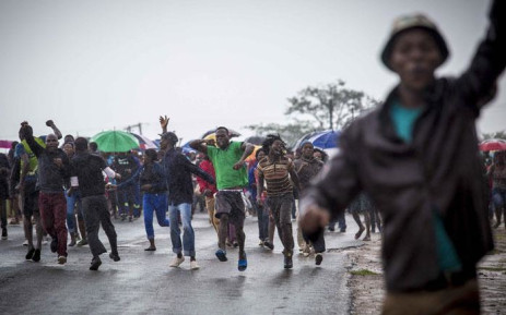 Residents of Vuwani, escorted by police, make their way into town and to the municipal offices on 6 February 2017. Picture: Thomas Holder/EWN.