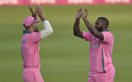 South Africa's Andile Phehlukwayo (R) celebrates with teammate Aiden Markram (L) after the dismissal of Pakistan's Faheem Ashraf (not visible) during the second one-day international (ODI) cricket match between South Africa and Pakistan at Wanderers Stadium in Johannesburg on 4 April 2021. Picture: Christiaan Kotze/AFP
