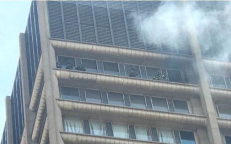 Five firefighters seen on the balcony of a burning building in Joburg. Picture: Christa Eybers/EWN