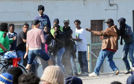 FILE: Migrants argue together during a food distribution in Calais, northern France, on 5 August, 2014. Picture: AFP