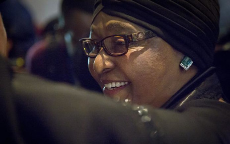 Struggle stalwart Winnie Madikizela-Mandela  smiles as she leaves the Nelson Mandela foundation after a memorial briefing for anti-apartheid activist Ahmed Kathrada on 28 March 2017. Picture: Reinart Toerien/EWN