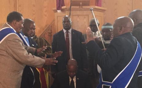 Church leaders praying for President Jacob Zuma, centre, at the St John's Apostolic Faith Mission in Everton. Picture: Thando Kubheka/EWN.