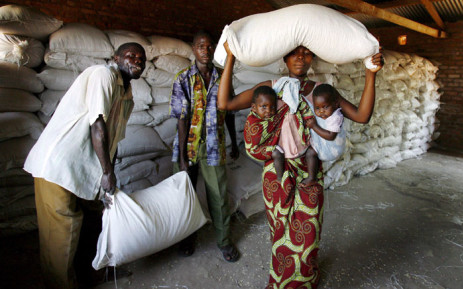 A local mother of twins collects her family's monthly food aid ration from a United Nations World Food Programme. Picture: EPA/ JON HRUSA