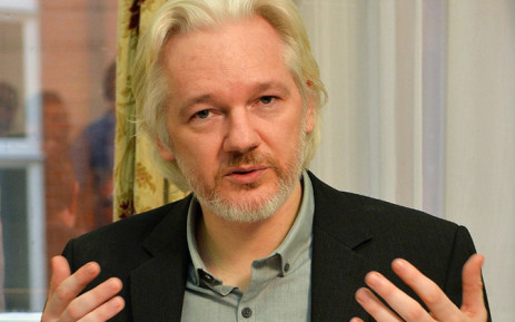 FILE: WikiLeaks founder Julian Assange gestures during a press conference inside the Ecuadorian Embassy in London in August 2014. Picture: AFP