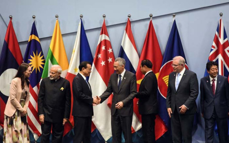 (L to R) New Zealand's Prime Minister Jacinda Ardern, India's Prime Minister Narendra Modi, Chinese Premier Li Keqiang, Singapore's Prime Minister Lee Hsien Loong, Thai Prime Minister Prayut Chan-O-Cha, Australia's Prime Minister Scott Morrison and Japan's Prime Minister Shinzo Abe arrive on stage to pose for a group photo during the 2nd Regional Comprehensive Economic Partnership summit (RCEP) on the sidelines of the 33rd Association of Southeast Asian Nations (ASEAN) summit in Singapore on 14 November 2018. Picture: AFP