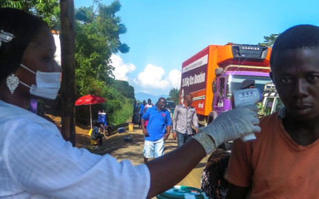 FILE:A Sierra Leone health worker takes the temperature of a man at a checkpoint in Port Loko district one of the hardest hit areas due to the Ebola virus Sierra Leone 25 October 2014. Picture: EPA.
