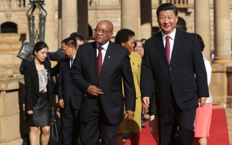 Chinese President Xi Jinping (R) and South African President Jacob Zuma (L) arrive for a meeting after the arrival ceremony of the Chinese President, at the Union Buildings in Pretoria, during the start of his official tour to South Africa on December 2, 2015. Picture: AFP