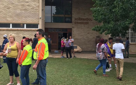 Parents and community members gather outside Hoërkool Driehoek in Vanderbijlpark on 1 February 2019 where at least 3 children died and 20 were seriously injured after a walkway in the school collapsed. Picture: Christa Eybers/EWN