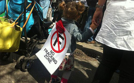 FILE: A small child takes part in an anti-fracking protest outside Parliament on 22 September 2012. Picture: EWN