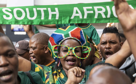 Fans gather at OR Tambo, singing and dancing as they welcome the national rugby team home. Picture: Thomas Holder/EWN.