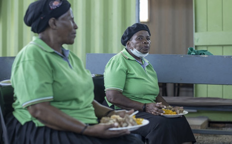 An elderly woman at the Sincedeni Elderly Centre eats a meal prepared with food rescued by Chefs with Compassion in Eldorado Park, Johannesburg, on February 17, 2021. Picture: Michele Sparati/AFP