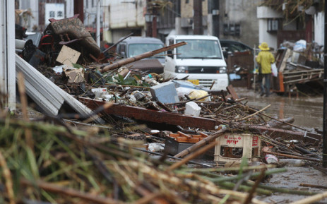 This picture shows a street covered by Debris in a flood-affected area following torrential rain in Hitoyoshi, Kumamoto prefecture, on 5 July 2020. Picture: AFP