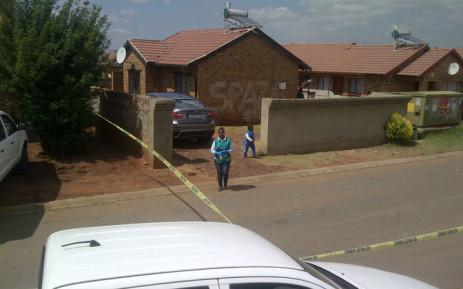 FILE: Crime scene investigators outside the Vosloorus house where Bafana Bafana captain Senzo Meyiwa was killed. Picture: Sapa.