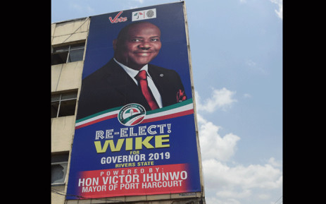 A campaign billboard of gubernatorial candidate of the Peoples Democratic Party (PDP) in Rivers State and incumbent Rivers State's governor Ezenwo Nyesom Wike in Port Harcourt, Rivers State, on 8 March 2019. Picture: AFP.