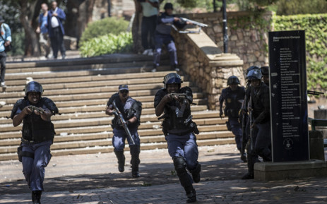 Policemen fire rubber bullets during running battles at the Witwatersrand University on 10 October 2016. Picture: AFP.