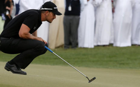 Swedens Henrik Stenson plays a shot during the final round of the DP World Tour Golf Championship in the Gulf emirate of Dubai on 17 November 2013. Picture: AFP