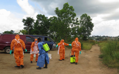 FILE:A Sierra Leone Red Cross burial team at Jobo Farm in Waterloo outside Freetown disinfects after recovering the bodies of those believed to have died of Ebola. Picture: EPA.