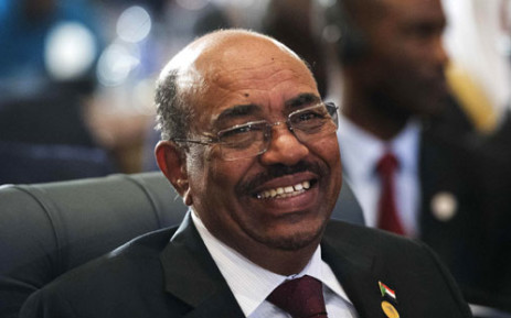 Sudanese President Omar al-Bashir smiles as he attends the 12th summit of the Organisation of Islamic Cooperation on February 6, 2013 in Cairo. Picture: AFP.