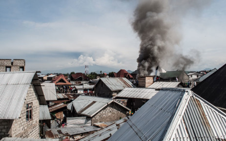 Smoke raises after a small aircraft crashed in a densely populated area in Goma on the East of the Democratic Republic of Congo on 24 November 2019.  Picture: AFP