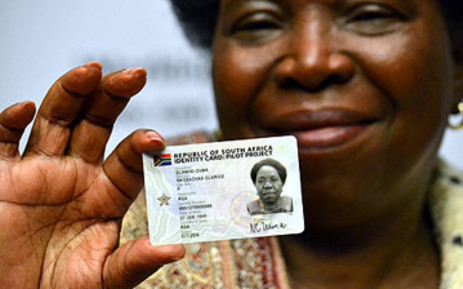 Home Affairs Minister Nkosazana Dlamini Zuma shows her new ID smart card during a media briefing in Cape Town on 25 April 2012. Picture: Aletta Gardner/EWN