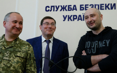 Russian journalist Arkady Babchenko (right), who was reported murdered in the Ukrainian capital on 29 May, Ukrainian Prosecutor General Yuriy Lutsenko (centre) and head of the state security service (SBU) Vasily Gritsak attend a news briefing in Kiev on 30 May 2018. Picture: Reuters