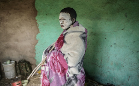 FILE: A Xhosa initiate stands during a traditional initiation process in a rural hut on 11 July 2017 in the Coffee Bay area in Umtata, South Africa. Picture: AFP