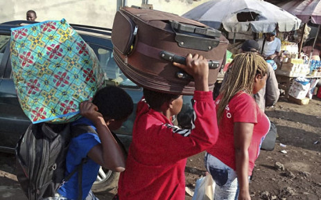 FILE: Residents from the Western Region in Cameroon arrive at the bus terminal in Buea following renewed clashed in the restive anglophone region on 15 July, 2018. Picture: AFP