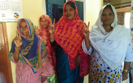 FILE: In this photo taken on 14 October 2019, Pinki Khatun (2nd R), the first transgender candidate elected in Bangladesh, poses with local women in Kotchandpur.  Picture: AFP