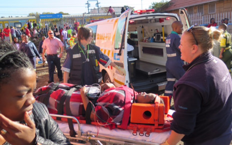 Paramedics and emergency services rush to help those trapped inside the two trains that collided at Denver Station, Southeast of Johannesburg on 28 April 2015. Picture: Louise McAuliffe/EWN.