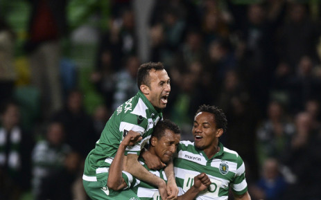 Sporting's Nani (C) celebrates with teammates Jefferson Nascimento (L) and Andre Carrilho after scoring during the Portuguese league football match Sporting CP vs Gil Vicente FC at the Alvalade stadium in Lisbon, on 22 February, 2015. Picture: AFP.