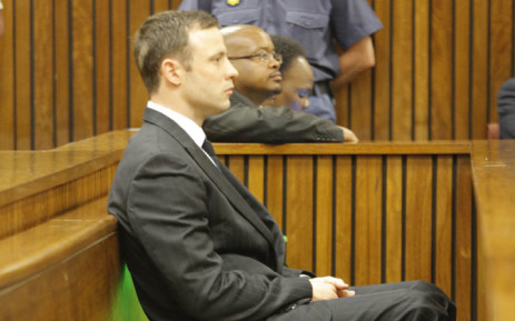 Oscar Pistorius in the dock during judgment in his murder trial in Pretoria on 11 September 2014. Picture: Pool.
