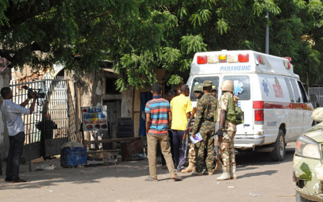 FILE: Emergency services and soldiers gather at the scene of a suicide bomb attack in Maiduguri. Picture: AFP.