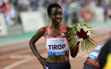 FILE: Agnes Jebet Tirop of Kenya celebrates after winning second-place in the women's 3,000 metres race during the Diamond League athletics competition at the Suhaim bin Hamad Stadium in Doha, on 4 May 2018. Picture: KARIM JAAFAR/AFP