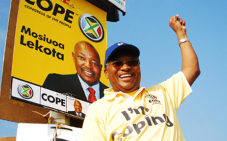 Mvume Dandala celebrates after putting up COPE's election poster in Midrand on 13 March, 2009. Picture: Taurai Maduna/Eyewitness News