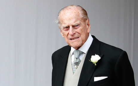 FILE: Britain's Prince Philip, Duke of Edinburgh waits for the carriage carrying Princess Eugenie of York and her husband Jack Brooksbank to pass at the start of the procession after their wedding ceremony at St George's Chapel, Windsor Castle, in Windsor, on 12 October 2018. Picture: AFP
