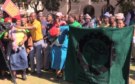 Marikana miners singing outside high court in pretoria on Monday 15 June. Picture; Kgothatso Mogale/EWN
