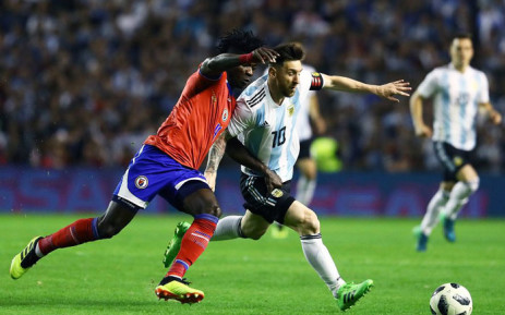 4d2a10a75 Argentina s Lionel Messi tussles with his Haiti opponent during a friendly  on 29 May 2018.
