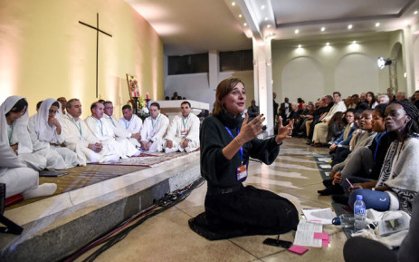 Youths sing in an interfaith choral segment during a spiritual vigil at the Cathedral of St Mary in Agleria's northwestern city of Oran on 7 December 2018, ahead of the beatification of seven French monks and 12 other clergymen killed during the Algerian civil war. Picture: AFP.