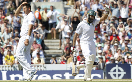 Hashim Amla celebrates after reaching 300 runs not out as England's Tim Bresnan (L) gestures during day 4 of the Test match between England and South Africa at the Oval in London.