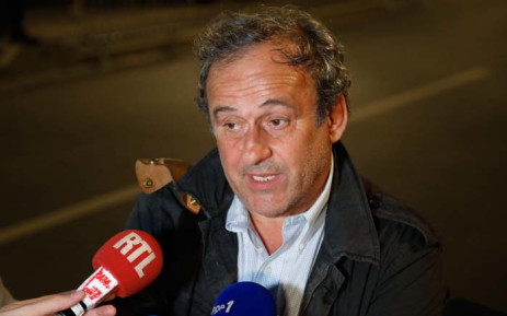 Ex-Uefa chief Michel Platini talks to the media in the early hours of 19 June 2019 before leaving the Central Office for Combating Corruption and Financial and Tax Crimes in Nanterre, west of Paris, after being questioned in connection with a criminal investigation into the award of the 2022 World Cup to Qatar. Picture: AFP.