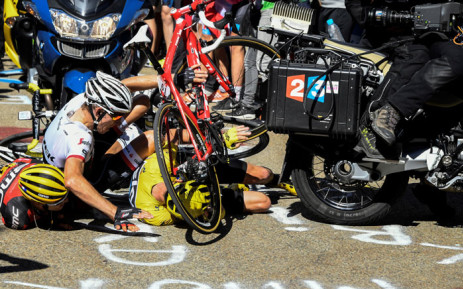(From L) Australias Richie Porte, Netherlands Bauke Mollema and Britain's Christopher Froome, wearing the overall leader's yellow jersey, fall on the ground during the 178 km twelvelth stage of the 103rd edition of the Tour de France cycling race on 14 July 2016 between Montpellier and Chalet-Reynard. Picture: AFP