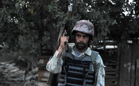 FILE:An Afghan soldier holds a rocket propelled grenade launcher following an attack by Taliban militants on the Afghan intelligence service office in Jalalabad on 30 August, 2014. Picture: AFP.